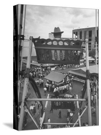 Texas Rancher with Kids, Perched 92-Ft. High on Ferris Wheel, Carnival Midway at County Fair