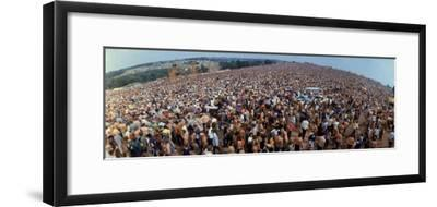 Wide Angle Overall of Huge Crowd Facing the Distant Stage, During the Woodstock Music and Art Fair