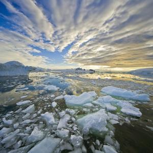Bergy Bits in Holtedehl Bay Under an Evening Sky by John Eastcott & Yva Momatiuk