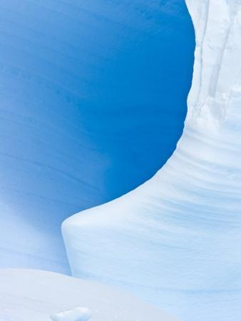 Blue Cave in Iceberg Sculpted by Waves