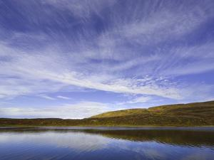 Cirrus and Cumulus Clouds Above Autumn Tundra in Denali National Park by John Eastcott & Yva Momatiuk