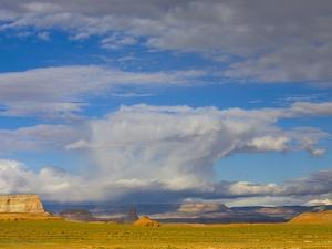 Clouds Over Buttes and Grassland by John Eastcott & Yva Momatiuk