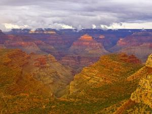 Clouds Over Grand Canyon and Buttes by John Eastcott & Yva Momatiuk