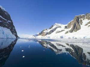 Coastal Mountains Bordering Gerlache Strait by John Eastcott & Yva Momatiuk