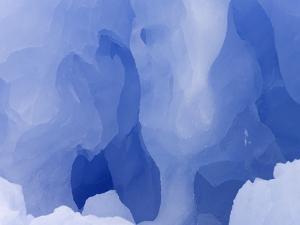 Eroded Blue Iceberg Floating at South Georgia Island by John Eastcott & Yva Momatiuk