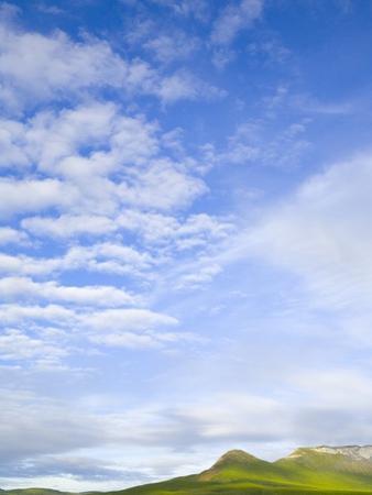Green Hills Under Cumulus Clouds in Canada