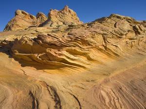 Grooves and Buttes in Desert Landscape by John Eastcott & Yva Momatiuk