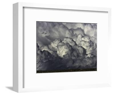 Heavy cumulus clouds above sagebrush desert