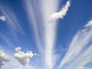 Lenticular and Cumulus Clouds by John Eastcott & Yva Momatiuk