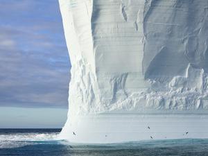 Massive Tabular Iceberg  Sculpted by Waves by John Eastcott & Yva Momatiuk
