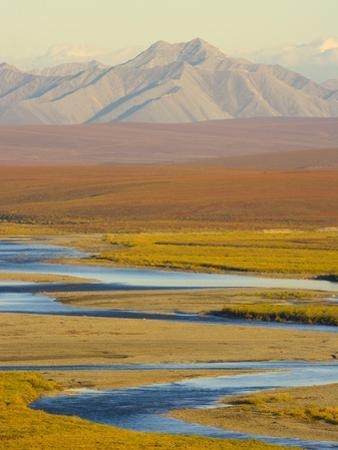 Mountains and Winding River in Tundra Valley