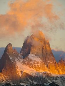 Pink Cumulus Clouds Above Fitzroy Massif by John Eastcott & Yva Momatiuk