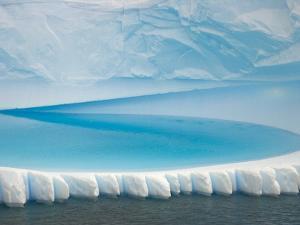 Stranded Iceberg in Shallow Bay Near Boothe Island by John Eastcott & Yva Momatiuk