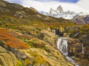 Waterfalls Cascading over Rocks near Fitzroy Range by John Eastcott & Yva Momatiuk