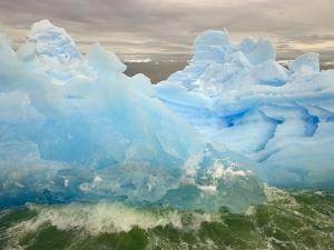 Waves Lapping Against Iceberg at the Antarctic Peninsula by John Eastcott & Yva Momatiuk