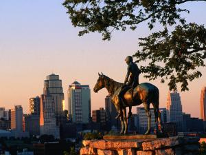 City Skyline Seen from Penn Valley Park, with Indian Statue in Foreground, Kansas City, Missouri by John Elk III