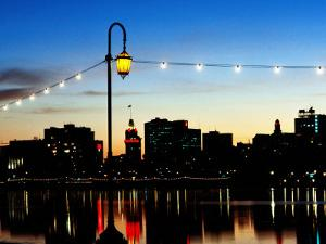 Lake Merritt with Lights at Sunset with City in Background, Oakland, California by John Elk III
