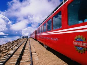 Pikes Peak Cog Railway Train with Visitors Looking Out from Pikes Peak by John Elk III