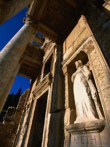 Statue in Library of Celsus from Greek and Roman Eras, Ephesus, Izmir, Turkey by John Elk III