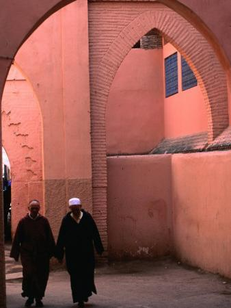 Two Men Walking along a Covered Street in the Medina, Marrakesh, Morocco