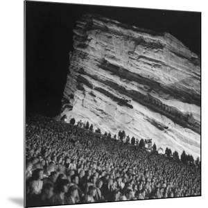 Audience Members Enjoying the Natural Acoustics of the Red Rocks Amphitheater During a Concert by John Florea