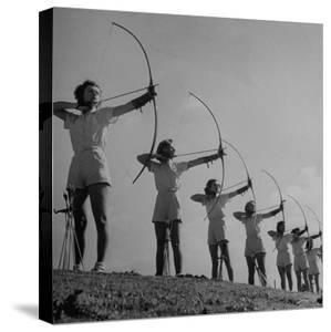 Girls Practicing Archery by John Florea
