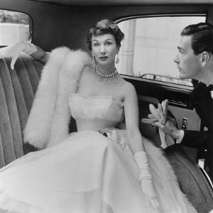 Barbara Goalen in a Julian Rose Evening Dress with Tommy Kyle, 1950 by John French