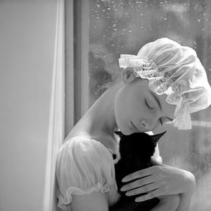 Model with Cap Embracing a Cat, 1960s by John French