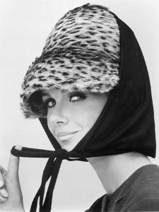 Nicole de la Marge in an Otto Lucas Jersey Scarf over an Ocelot Hat, 1964 by John French