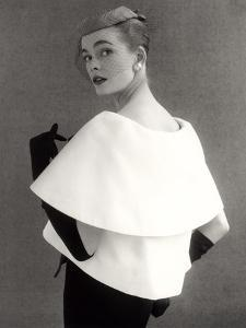 Susan Abraham in a John Cavanagh Tiered Evening Jacket, Dress and Hat, 1954 by John French