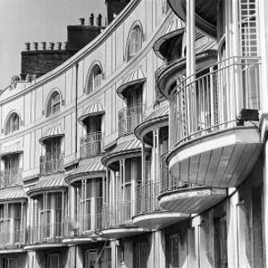 Facade of Building with Iron Balcony Detail by John Gay
