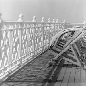 Railing at Brighton Pier with Sun Lounge, East Sussex by John Gay