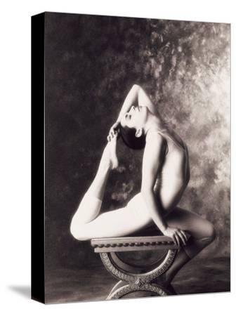 Ballerina Stretching Over Table