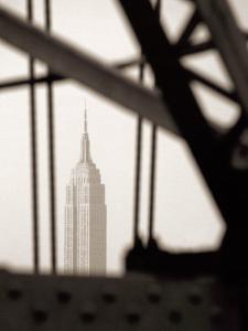 Empire State Building Through Manhattan Bridge by John Glembin