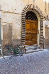 Bicycle parked outside front door, Lucca, Tuscany, Italy, Europe by John Guidi