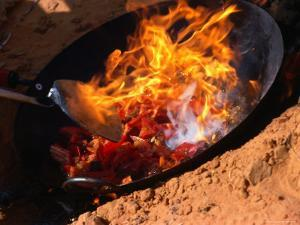 Cooking in Wok Over Camp Fire Simpson Desert, Australia by John Hay