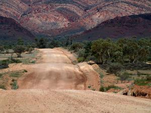 Dirt Road Through Mcdonnell Ranges West Macdonnell National Park, Northern Territory, Australia by John Hay