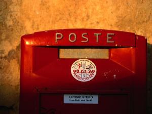 Red Post Box, Tuscany, Italy by John Hay