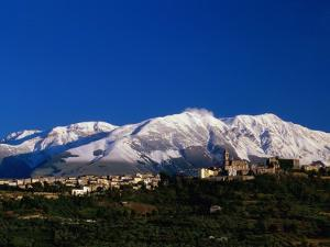 Town with Snow Covered Mountains in Background Tocco Da Casuaria, Abruzzo, Italy by John Hay