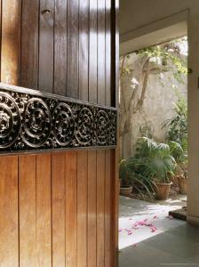 A Modern Front Door Decorated with a 400 Year Old Piece of Wood Carving by John Henry Claude Wilson