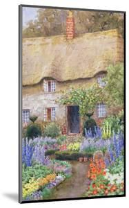 A Cottage Garden in Full Bloom by John Henry Garlick