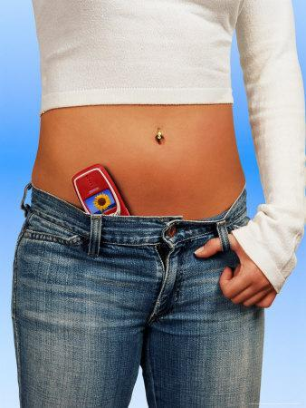 Woman with Cell Phone Tucked Into Her Jeans