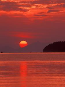 Andaman Sea Glows With Reflected Sunset, Thailand by John & Lisa Merrill