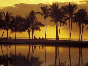Couple, Palm Trees and Sunset Reflecting in Lagoon at Anaeho'omalu Bay, Big Island, Hawaii, USA by John & Lisa Merrill