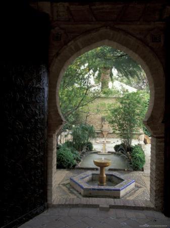 Doorway and Fountain in Courtyard of Palacio de Mondragon, Ronda, Spain