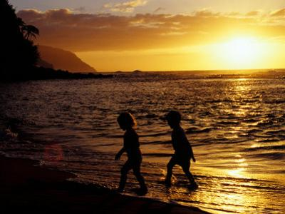 Kids on Beach at Sunset, Hawaii, USA