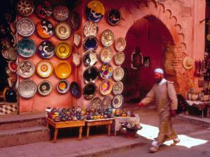 Muslim Man Walks by Wall of Moroccan Pottery, Marrakech, Morocco by John & Lisa Merrill