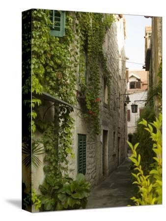 Narrow alley with historic stone buildings, Trogir, Dalamatia, Croatia