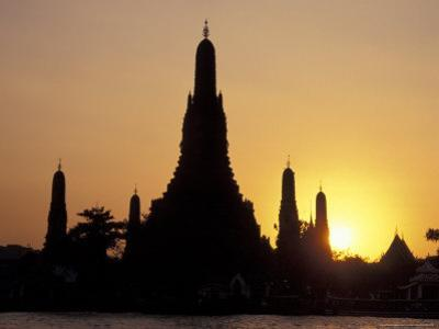 Sunset Behind Temple of Dawn on Chao Phraya River, Thailand