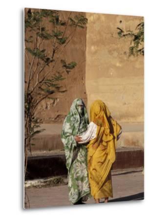 Veiled Muslim Women Talking at Base of City Walls, Morocco